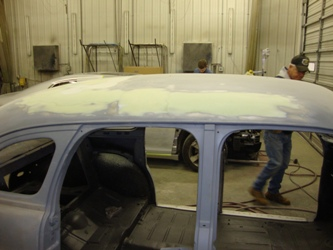 Final pre-paint prep work on the body is being completed.