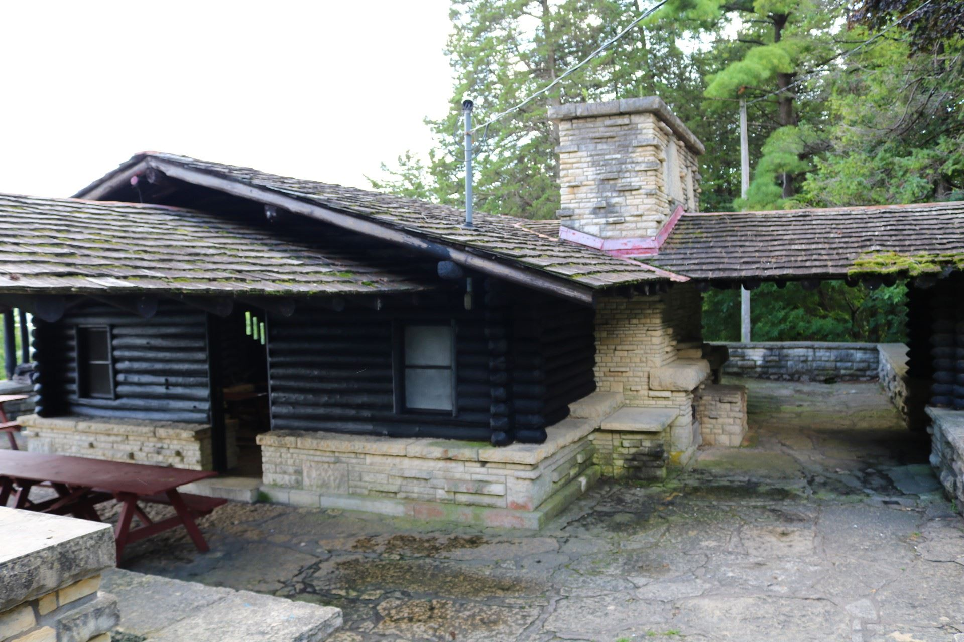 Log Cabin Pavilion seating: 110 people; price: $115.00. Large stone stairs down a hill, 20 amp elect